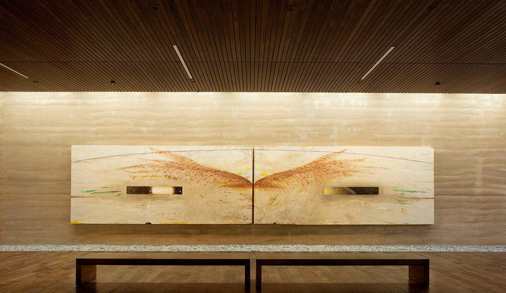 """Nathan Oliveira's """"The Windhover I A and I B"""" diptych. The mix design and texture of the rammed earth were carefully calibrated to complement the paintings : Photo credit © Matthew Millman"""