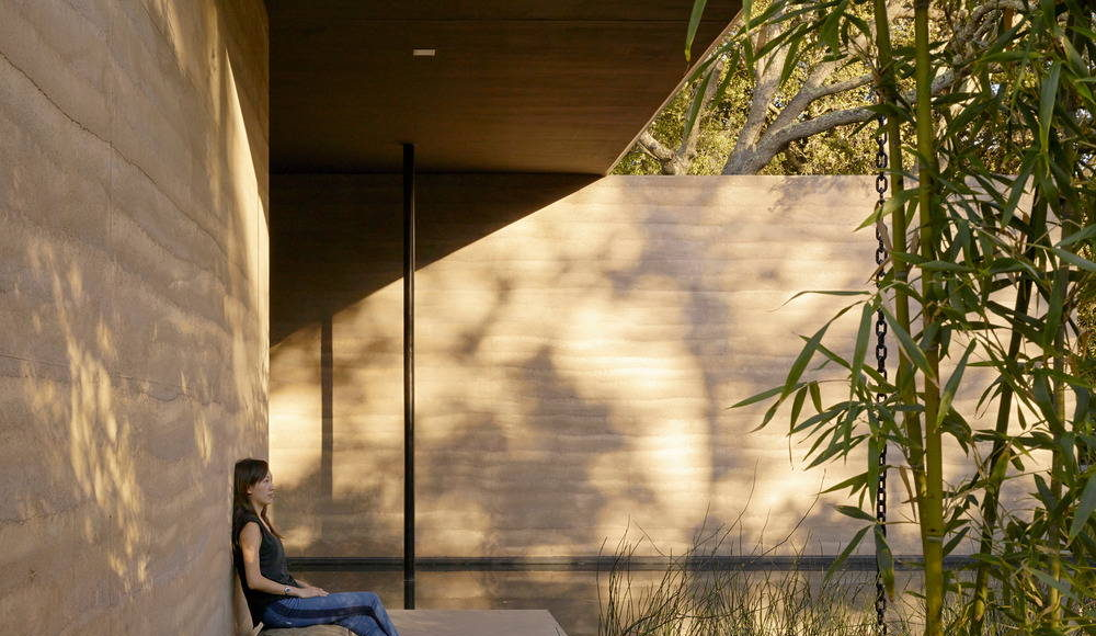 """A stone bench salvaged from Stanford's """"bone yard"""" provides a private spot for reflection : Photo credit © Matthew Millman"""