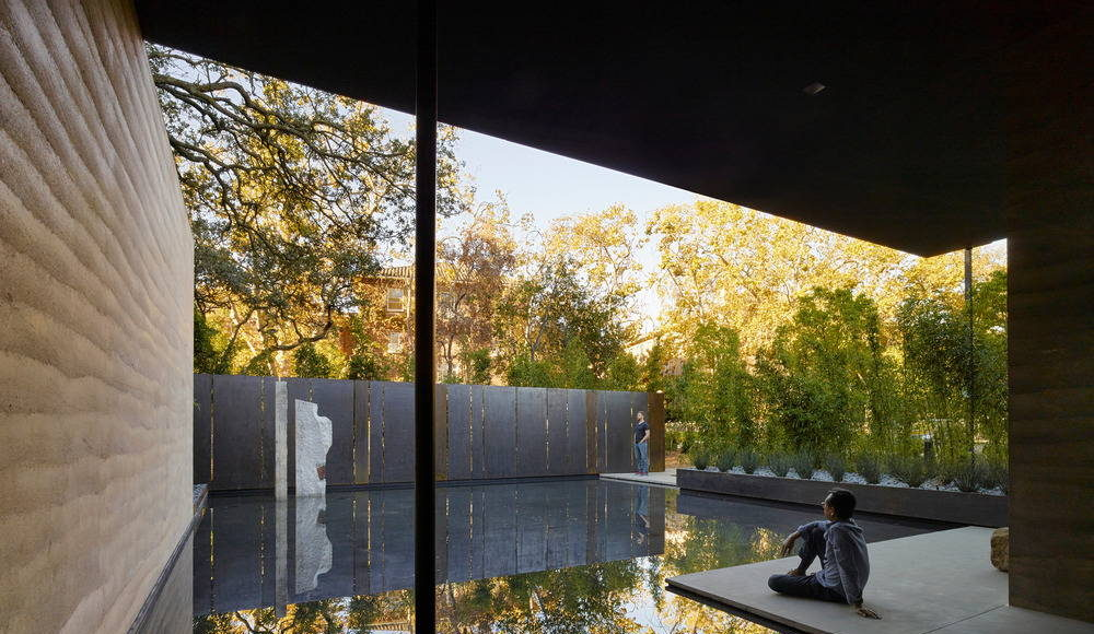 Water, in conjunction with landscape, is used throughout as an aid for contemplation; fountains within the main gallery and the courtyard provide ambient sound while a still reflecting pool to the south reflects the surrounding trees : Photo credit © Matthew Millman