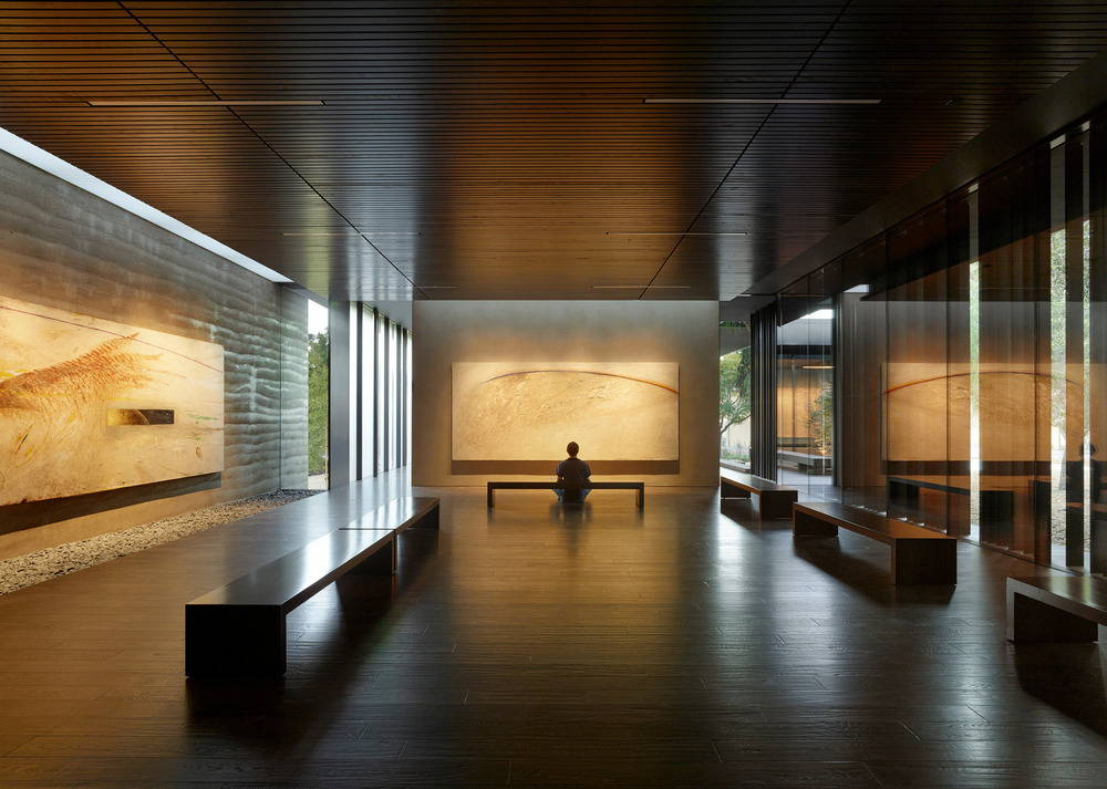 Finish materials and lighting are kept intentionally dark to focus the visitor's attention on the paintings : Photo credit © Matthew Millman