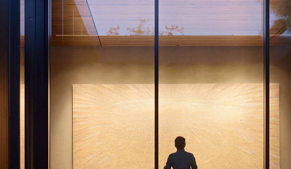 A fountain provides ambient sound to support contemplation while the fully glazed wall beyond allows views in the North Gallery : Photo credit © Matthew Millman
