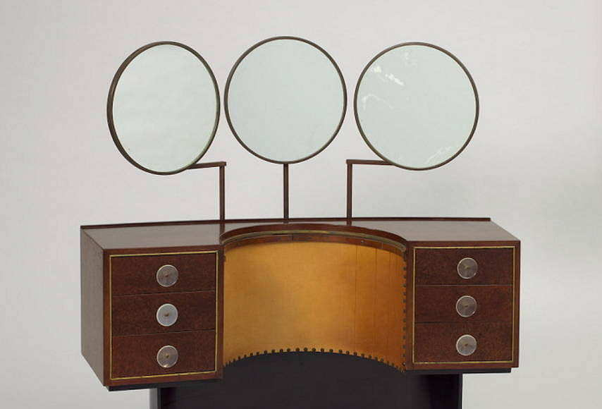 Designed by Gilbert Rohde (American, 1894 – 1944) Vanity Model 3920 Designed 1939 East Indian laurel, Sequoia burl, oak, acrylic, brass, patinated steel, leather, mirrored glass H x W x D: 127 × 127 × 43.2 cm (50 × 50 × 17 in.) Manufactured by Herman Miller Furniture Company (Zeeland, Michigan, USA) : Photo Matt Flynn © Smithsonian Institution