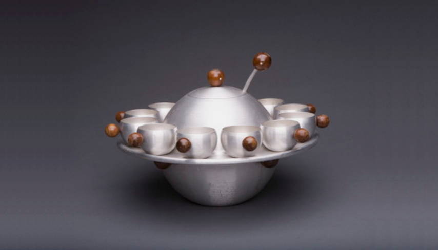 Russel Wright (1904–76) Saturn punch bowl with twelve cups and cup tray Designed ca. 1935 Aluminum, walnut Diameter: 18⅛ inches (46 cm) Produced by Wright Accessories/Raymor, New York, New York : Photo by © Shane Culpepper, Tulsa