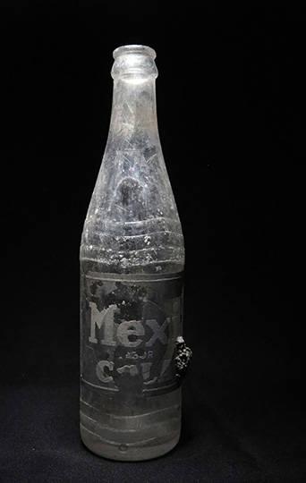 Envase de refresco Mexicola : Foto © Archivo del proyecto DSA-INAH
