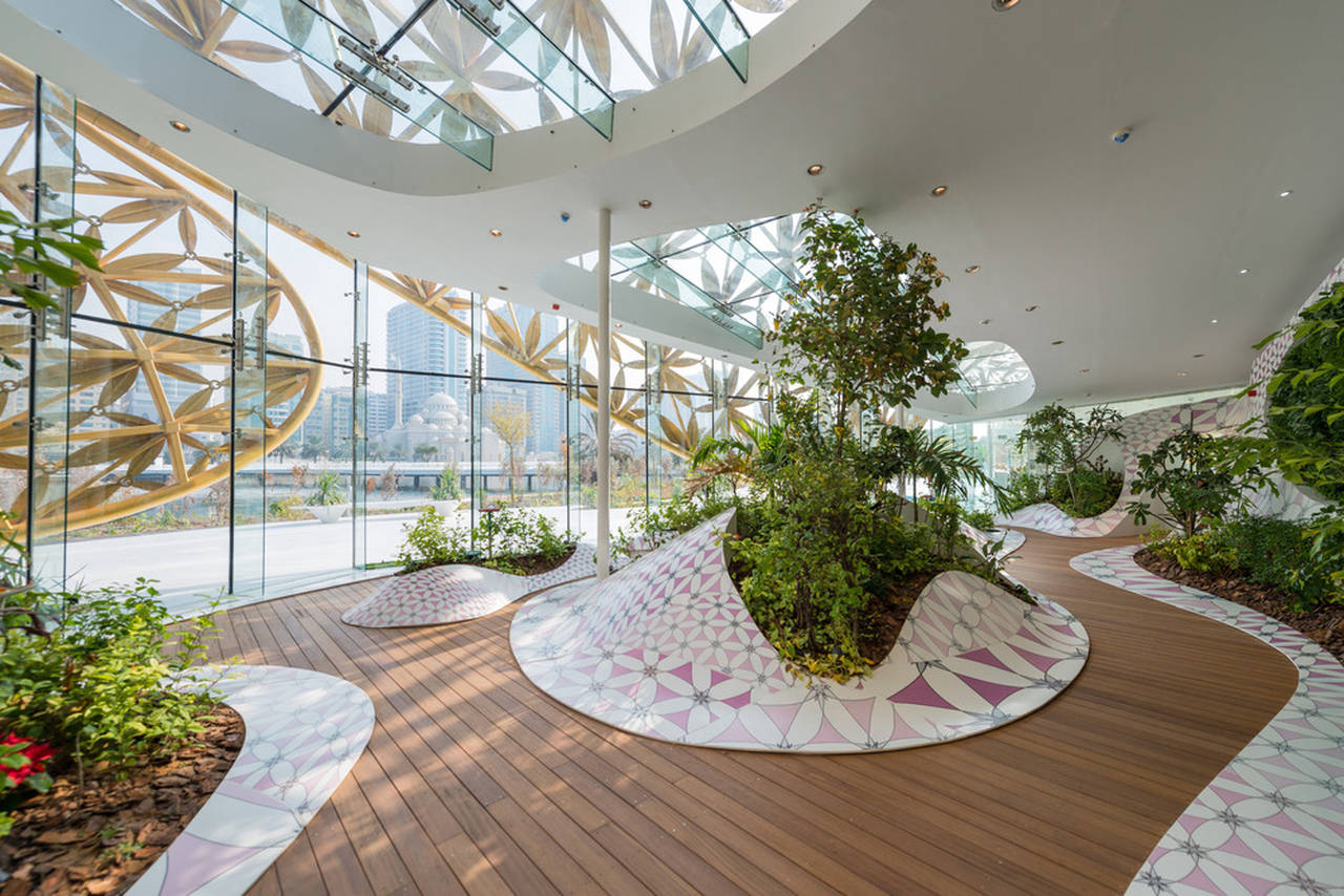 """The Butterfly Aviary illustrates 3deluxe's design principle"""" Multilayered Atmospheres"""": Inside, an undulating landscape made of thermoformed mineral material Krion merges horizontal and vertical : Photo credit © Joaquín Busch"""
