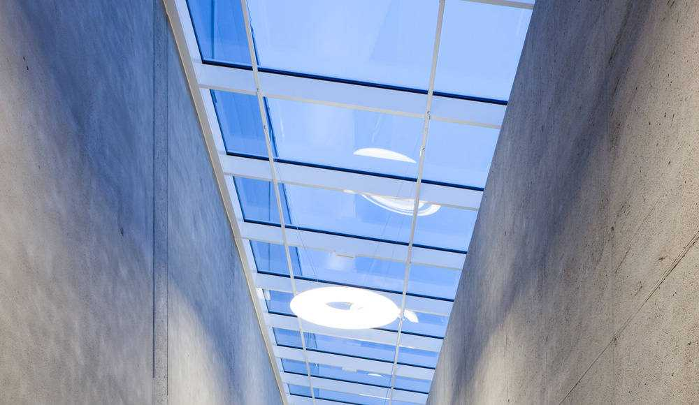 Light Fittings beneath a continuous roof light : Photo credit © Markus Kaiser