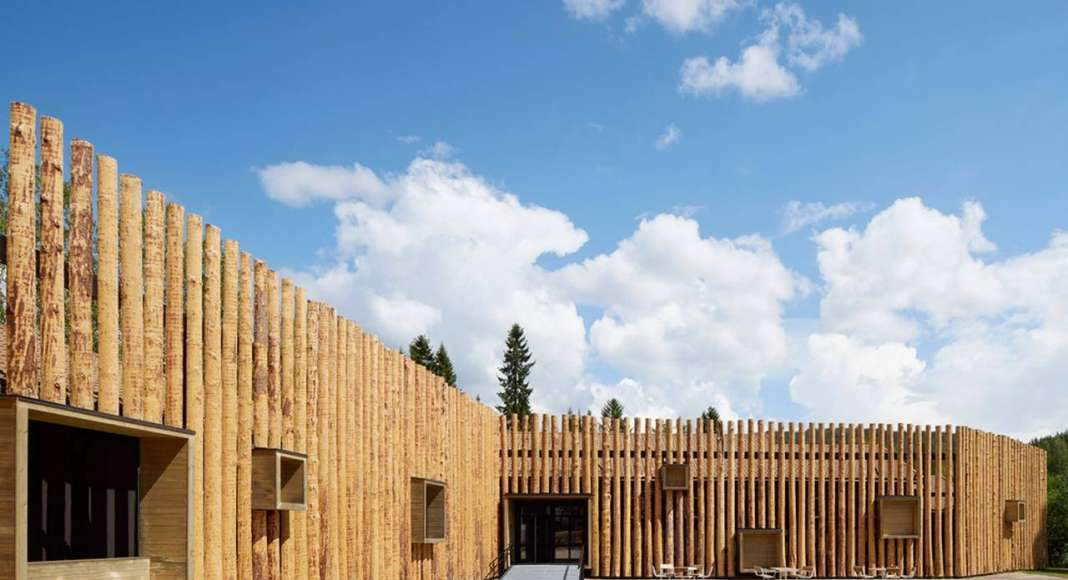 The protruding wooden boxes transform the building to an urban furniture : Photo credit © Åke E:son Lindman