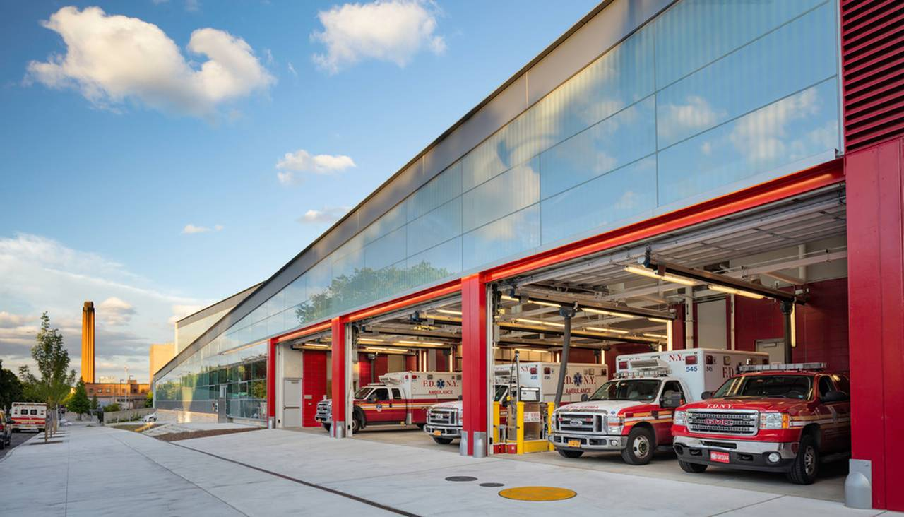 The signature FDNY-red overhead garage doors punctuate the street façade : Photo credit © Paul Warchol