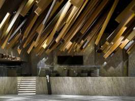 In the lobby, long rectangular-cuboid decorations extend from the ceiling, mimicking the motion of a meteor shower streaking through the sky : Photo credit © One Plus Partnership Limited & Jonathan Leijonhufvud