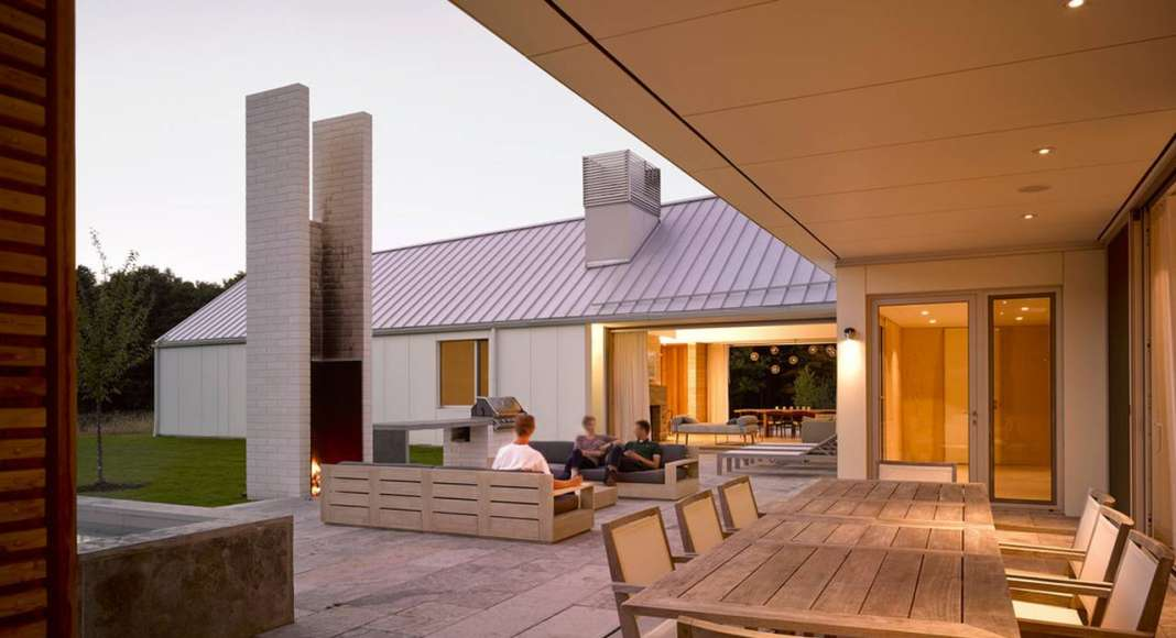 A view of the courtyard and covered dining space from Phase Two : Photo credit © Ben Rahn / A-Frame Studio
