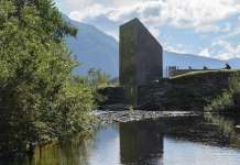The building is expressed as taking a piece out of the rock and moving it to the opposite side of the river : Photo credit © Steinar Skaar