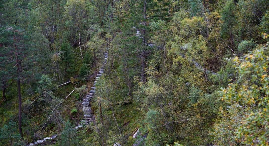 The Stairs: The terrain is steep and was almost impossible to walk in. The new trail, made of natural stone and formed in the terrain, became a central nerve of the project. It connects the different experiences of the waterfall and places of interest, creating a meeting of nature and culture : Photo credit © Pål Hoff