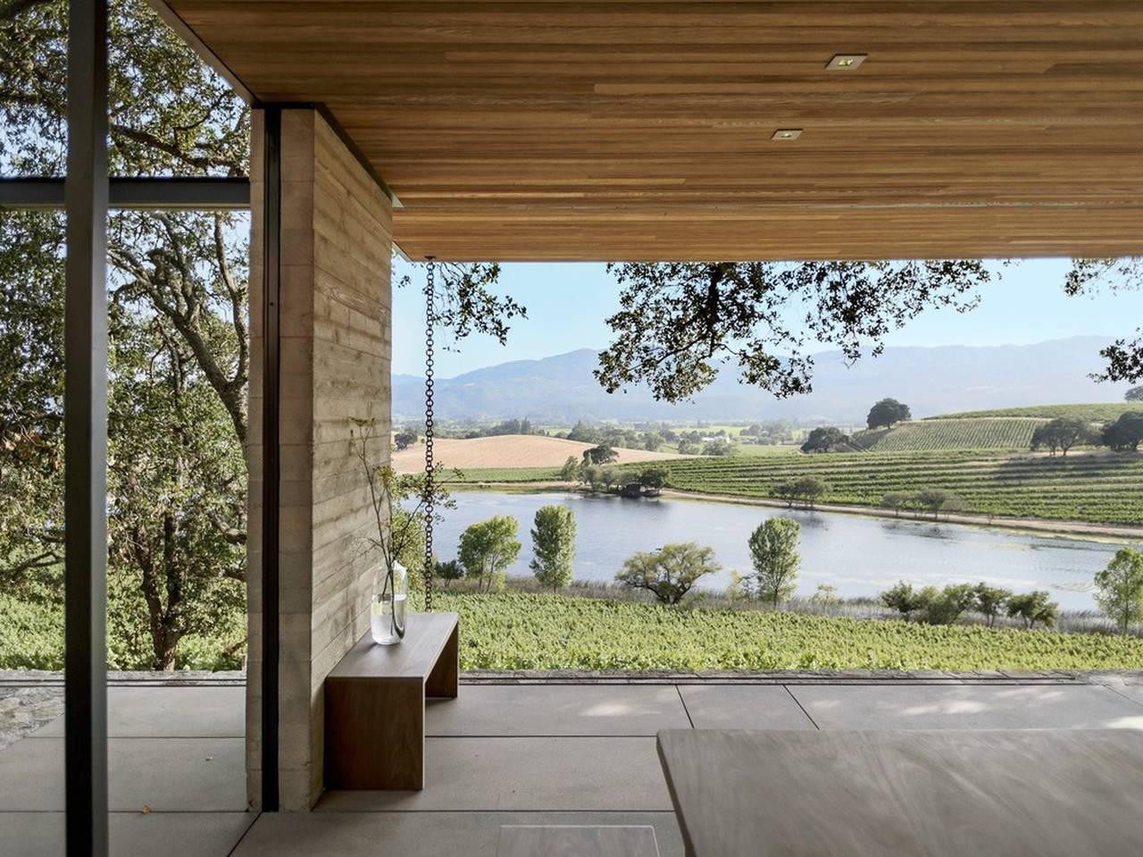 The pavilions present a serene setting where one can experience the vista of the vineyard and lake below : Photo credit © Matthew Williams