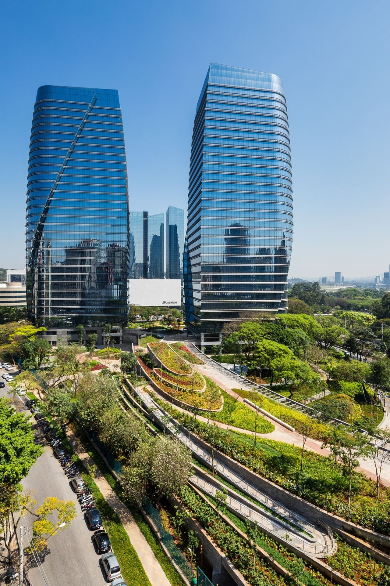 The continuous green surface weaves across the site around and through the two towers that make up the architectural program : Photo credit courtesy of © Ana Mello